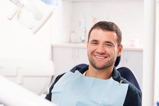 man smiling in dental chair | Central Park Dental Clinic