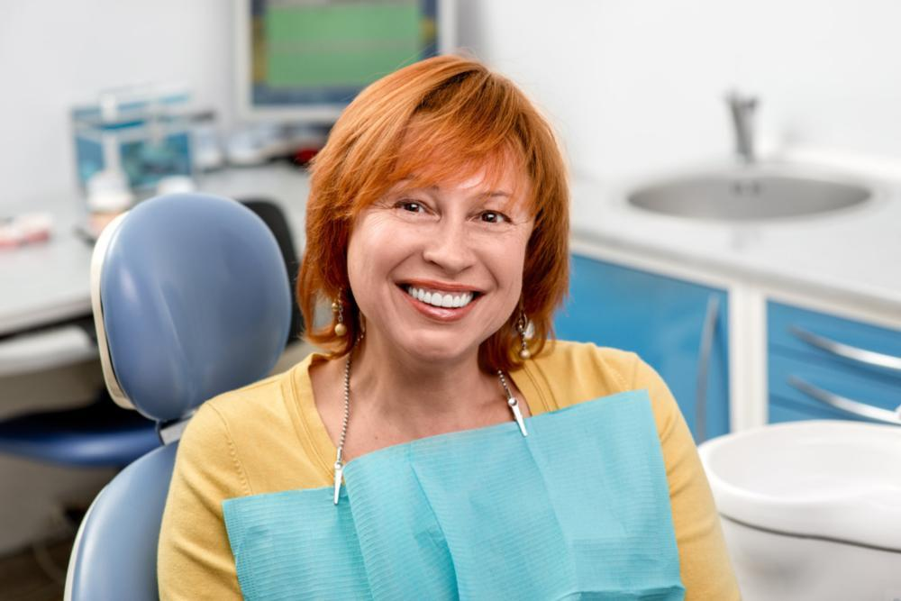 Woman sitting in dental chair smiling | Dentist Burnaby BC