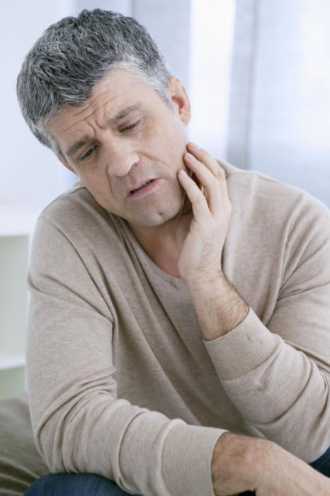 Man holding jaw from pain | Central Park Dental Clinic